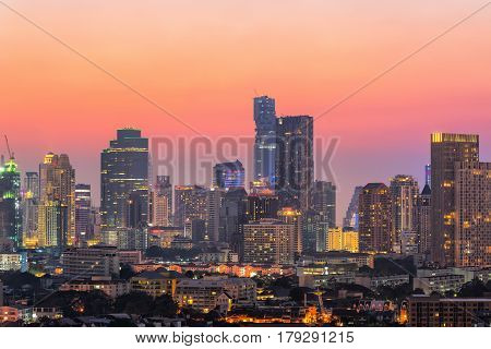 View of modern office buildings, condominium in big city downtown at twilight time,