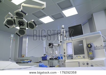 Operating room with covered table different medical equipment clean and prepared for the surgery