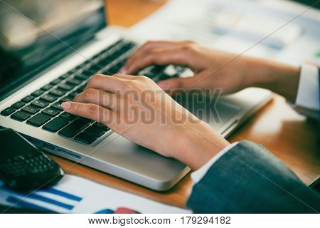Businesswoman typing keyboard in her own office