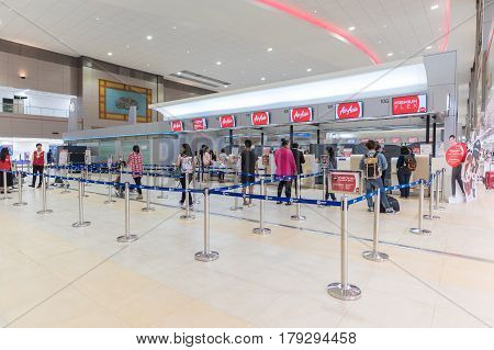 BANGKOK - MAR 29: Tourists waiting for check in for Air Asia airline at Don Mueang International Airport on March 29, 2016 in Bangkok,Thailand. Air Asia has been the world's best low-cost airline