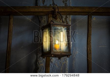 The Old Kerosene Lamp On A Wall In Dark Room