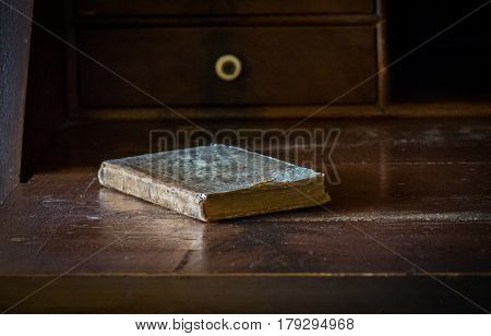 The Old And Vintage Book On A Wooden Table