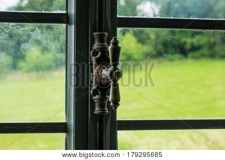 The Window With Latch Of An Old Farmhouse Inside