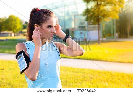 Sporty Woman Listening To Music With Earphones