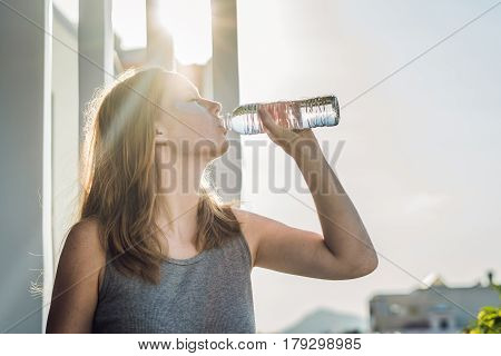 Portrait Of Beauty Red-haired Woman With Eye Patches Drinks Water. Spa Girl