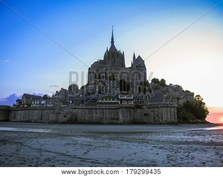 Scenic view of Mont Saint Michel monastery in sunset light, France