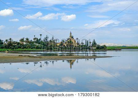 Hala Sultan Tekke Mosque at the Aliki Salt lake.  Beautiful sky with reflections.