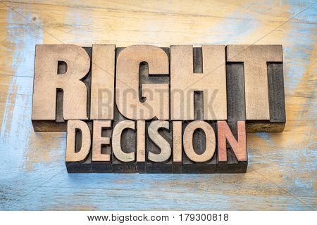 right decision word abstract in letterpress wood type printing blocks against grunge wooden surface