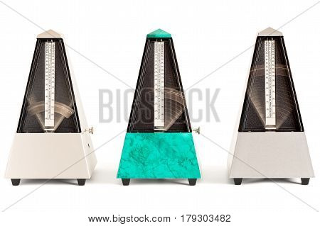 Three swinging pyramid shaped metronomes in plastic housing isolated on white