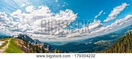 Alp mountain landscape with parachute by Brauneck