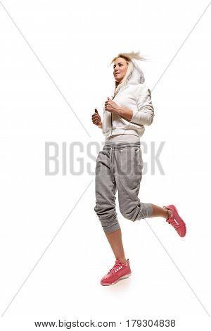 Running fit fitness sport model jogging isolated on white background. Caucasian fitness girl training.
