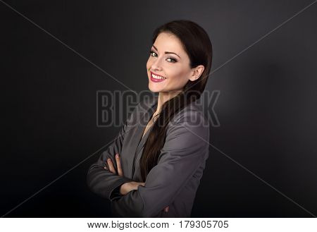 Beautiful Positive Toothy Smiling Business Woman In Grey Suit Looking Happy With Folded Arms On Dark