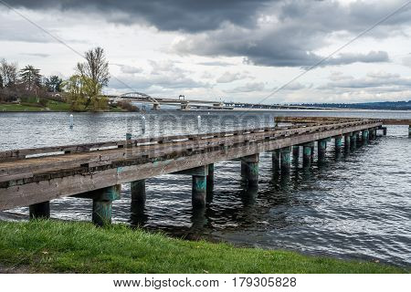 A view of a pier on Lake Washington in Seattle. Highway I-90 bridge in the distance.