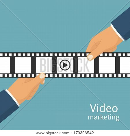 Video marketing concept. Video filming isolated. Movie time. Presentation advertise, blogging, share content. Coming soon. Holding a negative film in hand. Vector flat design. Isolated background.