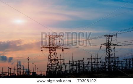 high-voltage power lines at sunset. electricity distribution station. high voltage electric transmission tower