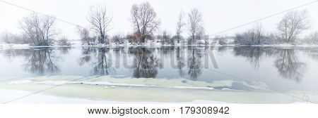 snowfall on a quiet river in the winter