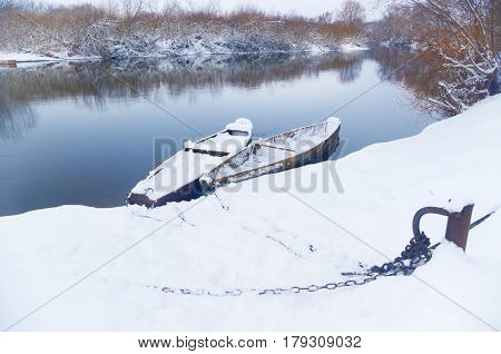 boats on the Bank of winter river