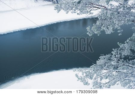 Winter river in the early misty morning