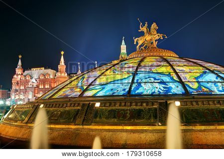 Glass cupola crowned by a statue of Saint George patron of Moscow at the Manege Square in Moscow, Russia