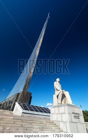 MOSCOW, RUSSIA - AUGUST 17, 2013: Monument to the Conquerors of Space and statue of Konstantin Tsiolkovsky the precursor of astronautics in Moscow.
