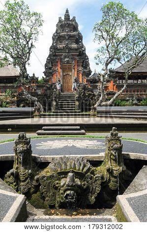 Ubud, indonesia - 10 February 2013: Lotus pond and Pura Saraswati temple in Ubud Bali Indonesia.