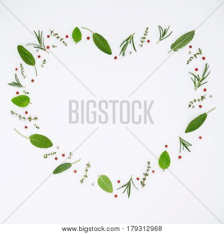 Heart Shaped Frame Various Fresh Herbs Rosemary, Sage ,thyme And Peppermint Leaves Flat Lay With Cen