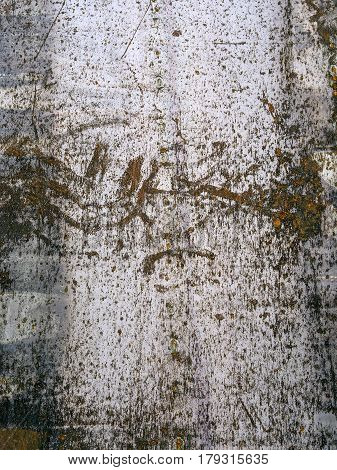 Metal texture with grunge cracks. Cracked paint on a metal surface. Urban background with transitions of rough paint.