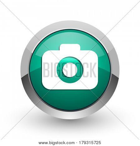 Photo camera silver metallic chrome web design green round internet icon with shadow on white background.