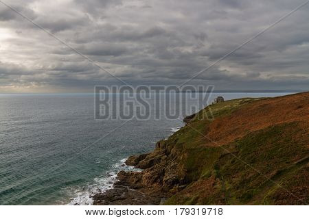 Rinsey Head And Cove With House In Cornwall