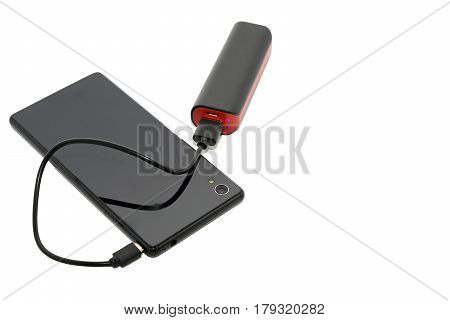 Smartphone charging with power bank on white background selective focus and soft focus Phone Charging.