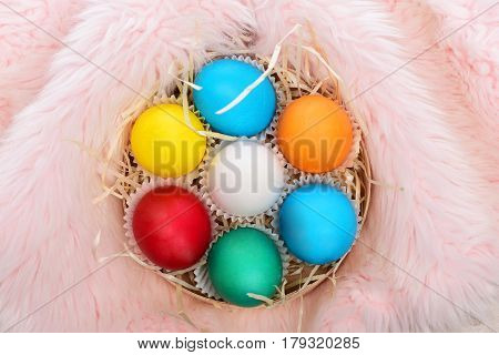 Painted Easter Colorful Eggs With Straw Nest In Pink Fur