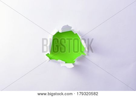 Green Paper In The Hole On The White Paper. Conceptual Background