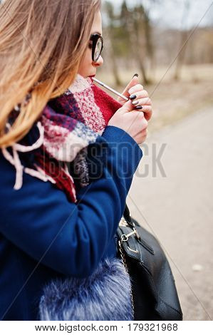 Young Girl Lighting Cigarette Outdoors Close Up. Concept Of Nicotine Addiction By Teenagers.