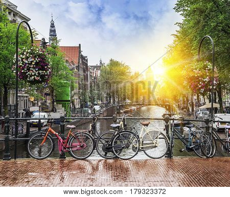 Beautiful sunset in Amsterdam. Rainy day in Amsterdam with glimpses of the evening sun.