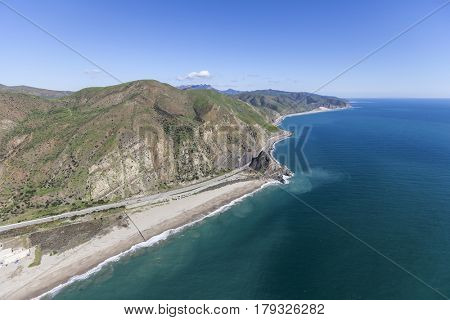 Aerial view of Pacific Coast Highway at Mugu Rock north of Malibu California.
