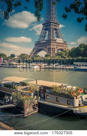 Residential barge and tourist ships on the Seine near the Eiffel Tower, Paris, France