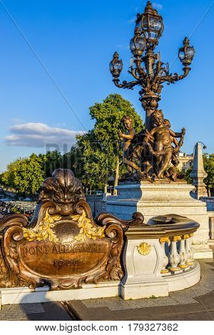 Detail of the Pont Alexandre III: the lantern with statues of Nymphs in Paris, France. This bridge was named after russian Tsar Alexander III.