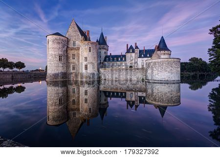 The chateau of Sully-sur-Loire at night, France. This castle is located in the Loire Valley, dates from the 14th century and is a prime example of medieval fortress.