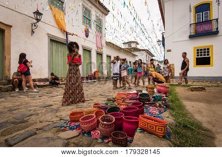 Paraty, Brazil - February 25, 2017: Brazilian Indian handicrafts for sale in the streets of the old town of Paraty.