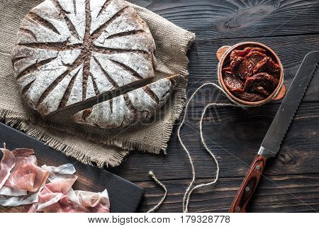 Rye bread with antipasto on the wooden board