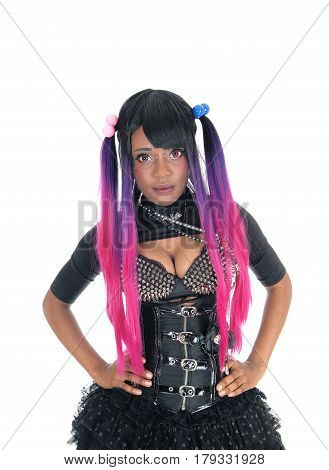 A beautiful African American steam punk woman in a corset and spike bra standing from the front isolated for white background.
