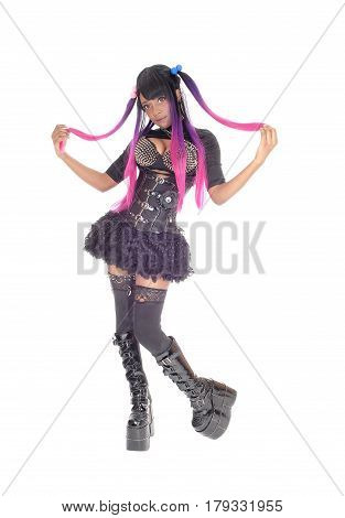 A beautiful African American steam punk woman in a corset and spike bra standing in short skirt and long boots isolated for white background.