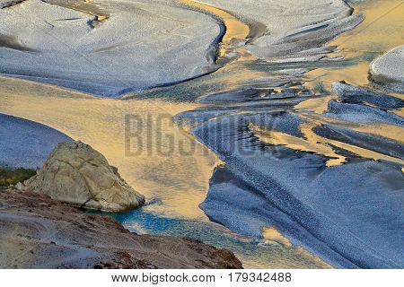 The Riverbed Of The Nubra River At Sunset: A Reflection Of The Sun Coloring The Surface Of The Water