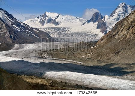 Dag Tug Glacier: A Huge Firn Glove Tongue, Gray Moraine At The Edges And High, Snow-capped Mountain