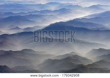 Blue And Brown Silhouette Towering Mountains Himalayas, Including The White Clouds, Northern India.