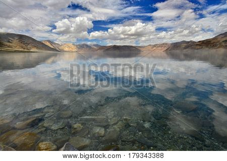 High Mountains Pangong Lake: The Lake Is Clear And Blue Surface, Calm As A Mirror And Reflects The M