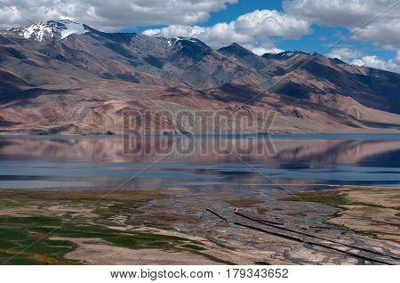 Floodplain High Mountains Of Lake Tso Moriri: Pink Mountains, The River Flows Into A Blue Lake, Gree