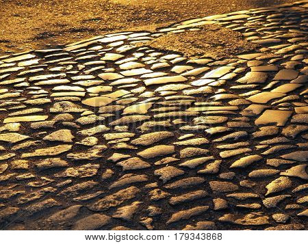 Ancient Pavement: Paving Blocks Are Made Of Old Cobbles Of Different Sizes, Arranged In Rows, In The