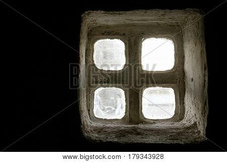 A White Antique Window With Small Misted Glasses On A Black Background.
