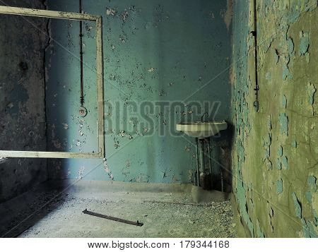 A Vintage Washbasin In The School Corridor In Pripyat: Blue Walls With Crumbling Plaster, Wires, Cra
